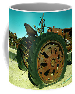 rusty-old-tractor-with-a-flat-tire-jeff-