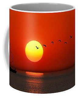 Coffee Mug featuring the photograph Sailboat At Sunset by Joe Bonita