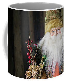 Santa Claus Doll In Green Suit With Forest Background. Coffee Mug