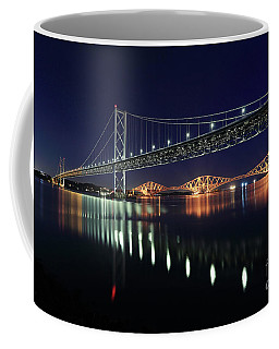 Coffee Mug featuring the photograph Scottish Steel In Silver And Gold Lights Across The Firth Of Forth At Night by Maria Gaellman