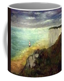 Sea, Cliffs, Beach And Lighthouse Coffee Mug