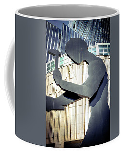 Coffee Mug featuring the photograph Seattle Hammering Man by Spencer McDonald