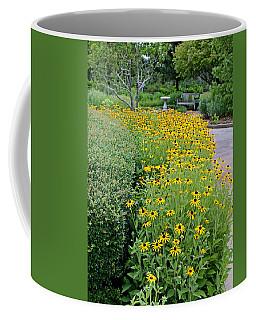 Coffee Mug featuring the photograph Secret Garden by Judy Vincent