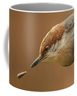 Coffee Mug featuring the photograph Seed Evades Nuthatch by Jim Moore