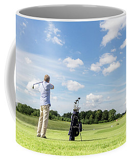 Senior Fit Man Hitting A Golf Ball. Coffee Mug