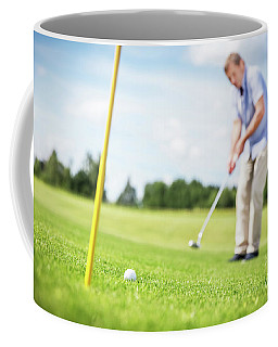 Senior Man Putting A Ball In The Hole. Coffee Mug