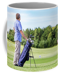 Senior Man Standing Proudly On A Golf Club. Coffee Mug