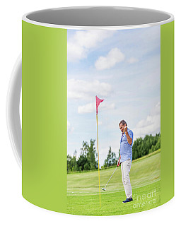Senior Man Winning Game On A Golf Course. Coffee Mug