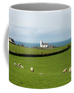 Coffee Mug featuring the photograph Sheep Grazing On Irish Coastline by Juli Scalzi