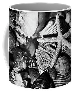 Coffee Mug featuring the photograph Shells And Starfish In Black And White by Angie Tirado