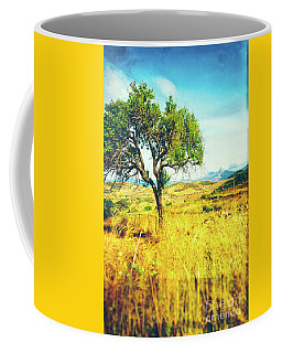 Coffee Mug featuring the photograph Sicilian Landscape With Tree by Silvia Ganora