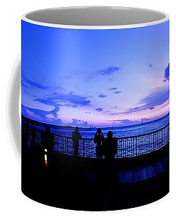 Coffee Mug featuring the photograph Silhouette Of People At Sunset by Yali Shi