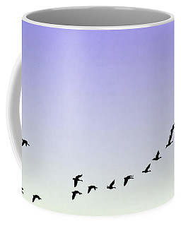 Silhouetted Flight Coffee Mug by Brian Wallace