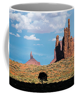 Coffee Mug featuring the photograph Silhouetted Tree At Monument Valley by Mary Lee Dereske