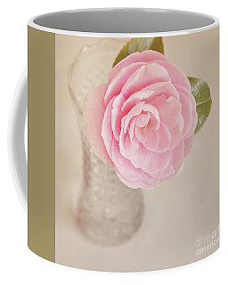 Coffee Mug featuring the photograph Single Pink Camelia Flower In Clear Vase by Lyn Randle