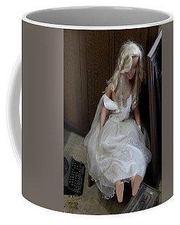 Coffee Mug featuring the photograph Sitting Doll by Viktor Savchenko