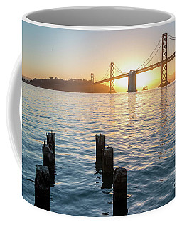 Six Pillars Sticking Out The Water With Bay Bridge In The Backgr Coffee Mug