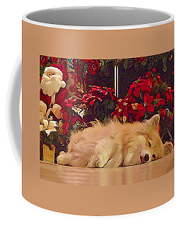 Coffee Mug featuring the photograph Sleepy Holiday Corgi Surrounded By Poinsettias. by Kathy Kelly