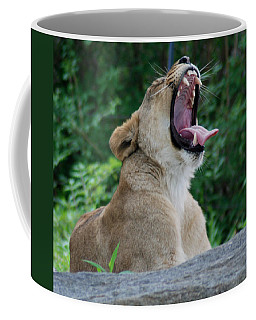 Coffee Mug featuring the photograph Sleepy Lion by Richard Bryce and Family