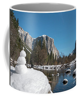 Coffee Mug featuring the photograph Small Snow Man Next To Yosemite River With El Capitan And Plane  by PorqueNo Studios