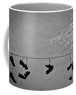 Coffee Mug featuring the photograph Sneakers On A Wire by Stuart Litoff