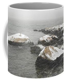 Snow Blowing In The Wind Over The Rocks Coffee Mug