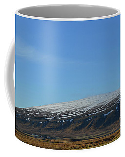 Snow Capped Rhyolite Mountains In Iceland Coffee Mug by DejaVu Designs