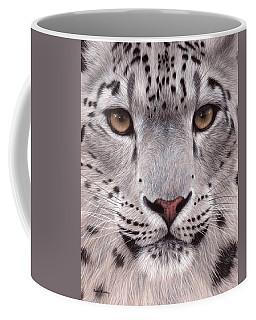 Snow Leopard Face Coffee Mug by Rachel Stribbling