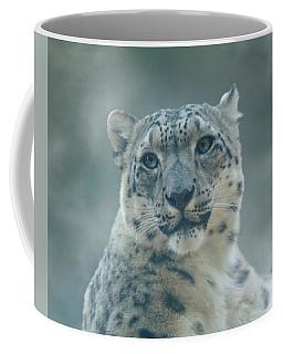 Coffee Mug featuring the photograph Snow Leopard Portrait by Sandy Keeton