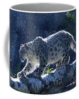 Coffee Mug featuring the photograph Snow Leopard Walk by Phil Banks