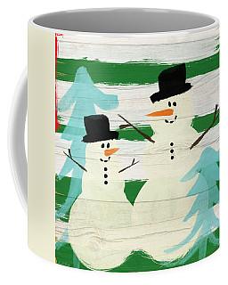 Snowmen With Blue Trees- Art By Linda Woods Coffee Mug