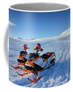 Coffee Mug featuring the photograph Snowmobiles In Iceland In Winter by Matthias Hauser