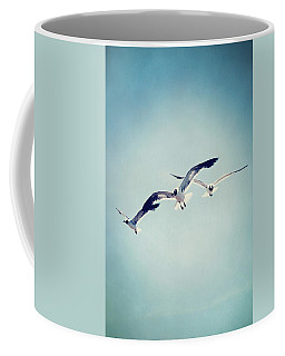 Coffee Mug featuring the photograph Soaring Seagulls by Trish Mistric