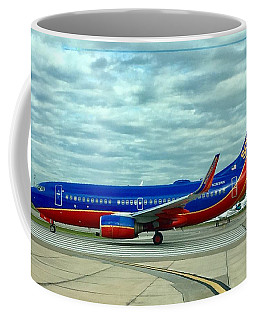 Coffee Mug featuring the digital art Southwest 737 At Hobby by James Weatherly