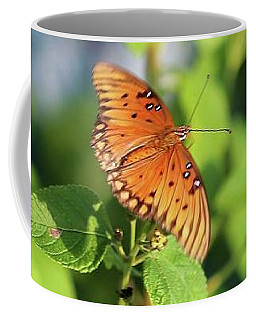Coffee Mug featuring the photograph Spreading Wings by Ellen Barron O'Reilly
