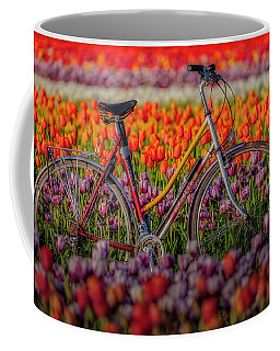 Coffee Mug featuring the photograph Spring Tulips And Bicycle by Susan Candelario