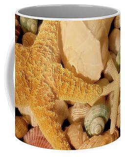 Coffee Mug featuring the photograph Starfish And Seashells by Angie Tirado