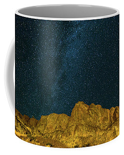Starry Night Sky Over Rocky Landscape Coffee Mug