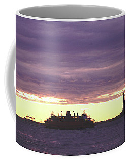 Coffee Mug featuring the photograph Statue Of Liberty And Ferry Dramatic Sunset by Tom Wurl