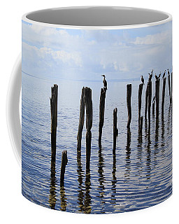 Coffee Mug featuring the photograph Sticks Out To Sea by Stephen Mitchell