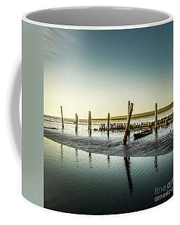 Coffee Mug featuring the photograph Still Standing by Hannes Cmarits