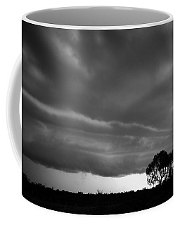 Coffee Mug featuring the photograph Storm Passing Over Solitary Tree In The Desert by Keiran Lusk