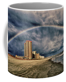 Coffee Mug featuring the photograph Stormy Rainbow by Kelly Reber