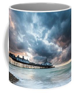 Stormy Sunrise Over Eastbourne Pier Coffee Mug
