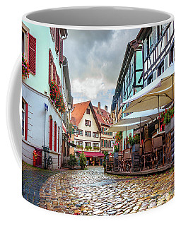 Coffee Mug featuring the photograph Street Cafe After The Rain by Dmytro Korol