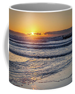 Sun Behind Clouds With Beach And Waves In The Foreground Coffee Mug