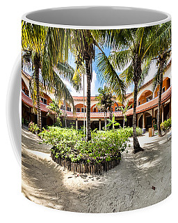 Coffee Mug featuring the photograph Sun Breeze Hotel by Lawrence Burry