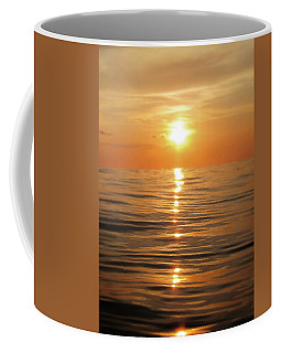 Sun Setting Over Calm Waters Coffee Mug