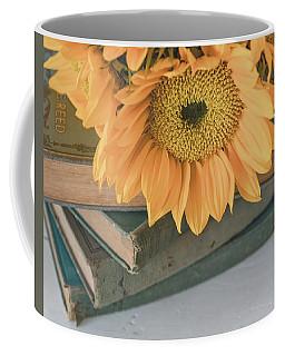 Coffee Mug featuring the photograph Sunflowers And Books by Kim Hojnacki