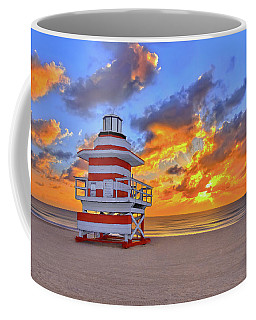 Coffee Mug featuring the photograph Sunrise Over Lifegaurd Stand On South Miami Beach  by Justin Kelefas